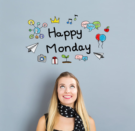 Happy Monday concept with happy young woman on a gray background