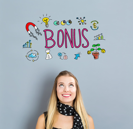 small business woman: Bonus concept with happy young woman on a gray background Stock Photo