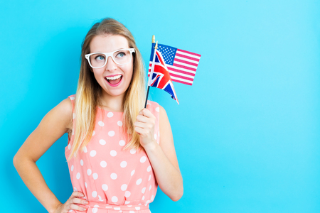 british girl: Young woman with flags of English speaking countries Stock Photo