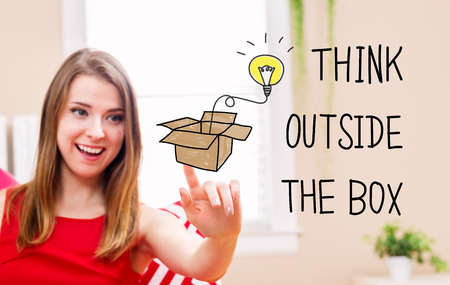 many: Think Outside The Box concept with young woman in her home