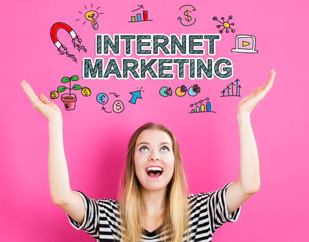 internet marketing: Internet Marketing concept with young woman reaching and looking upwards