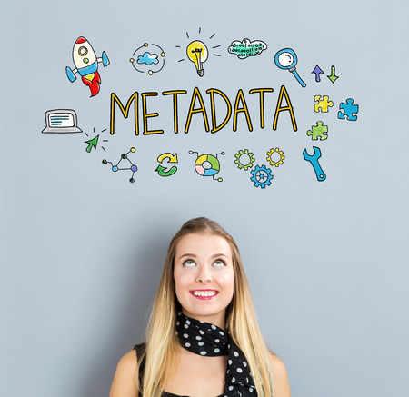 metadata: Metadata concept with happy young woman on a gray background
