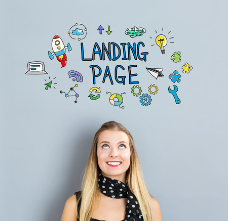 small business woman: Landing Page concept with happy young woman on a gray background Stock Photo