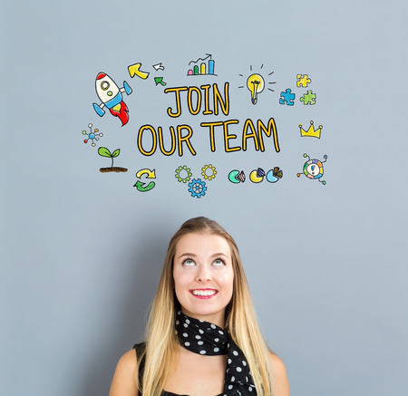 join: Join Our Team concept with happy young woman on a gray background Stock Photo