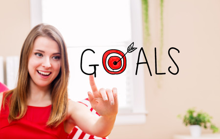 Goals concept with young woman in her home
