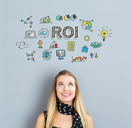 small business woman: RoI concept with happy young woman on a gray background