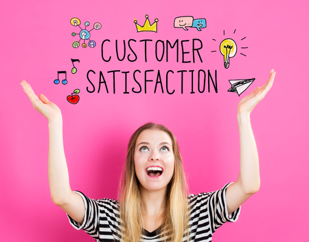 looking upwards: Customer Satisfaction concept with young woman reaching and looking upwards Stock Photo