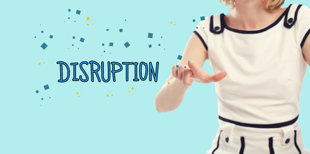 disruption: Disruption concept with young woman on a blue background Stock Photo