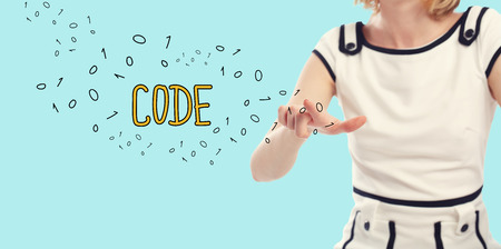 Code concept with young woman on a blue background Stock Photo