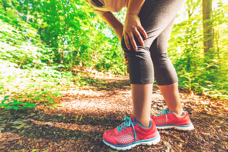 Female runner with sports injury of the knee