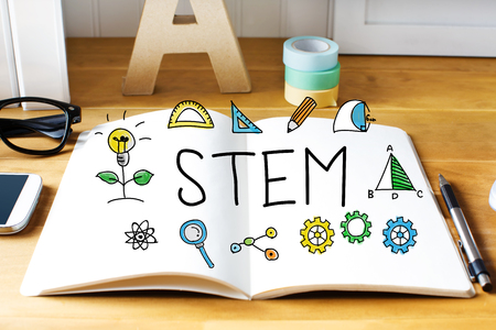 stems: Stem concept with notebook on wooden desk