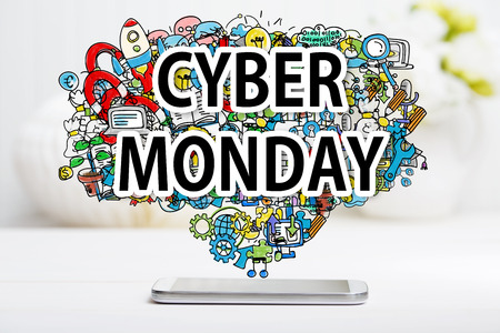 Cyber Monday concept with smartphone on white table Stock Photo