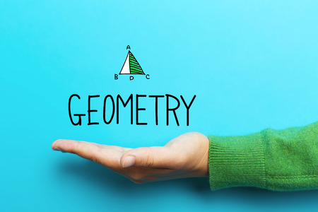 Geometry concept with hand on blue background Stock Photo