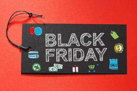 Blank Friday text on a black tag on a red paper background