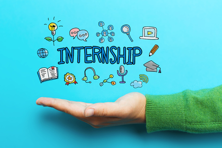 trainee: Internship concept with hand on blue background