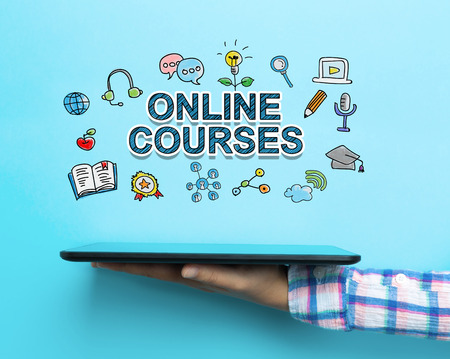 courses: Online Courses concept with a tablet on blue background