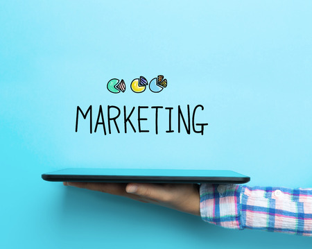 technology market: Marketing concept with a tablet on blue background Stock Photo