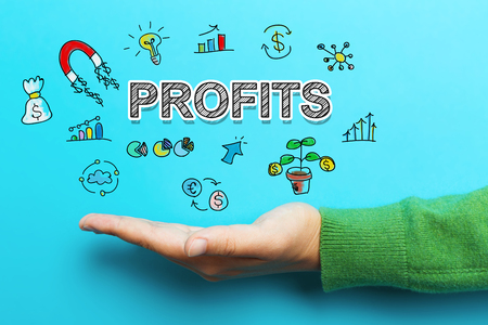 Profits concept with hand on blue background