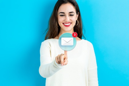 Email icon with young woman on a blue background Stock Photo - 64984442