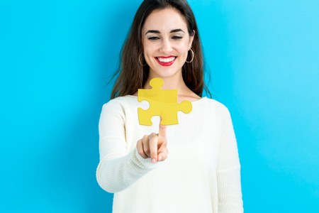 business challenge: Puzzle icon with young woman on a blue background
