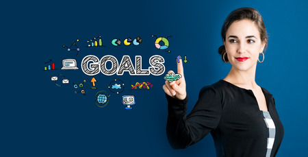 settings: Goals concept with business woman on a dark blue background Stock Photo