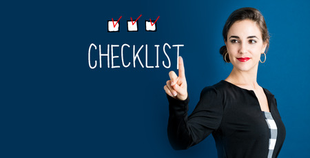 checklist: Checklist concept with business woman on a dark blue background