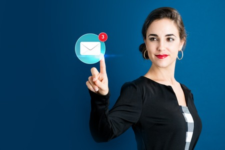 Email icon with business woman on a dark blue background Stock Photo