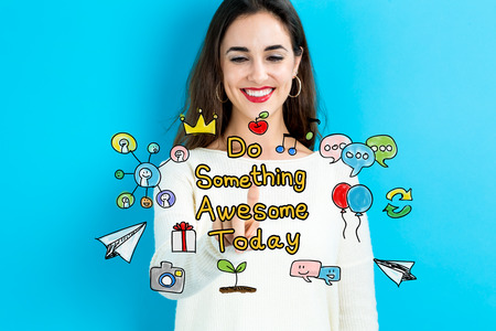 Do Something Awesome Today text with young woman on blue background Stock Photo