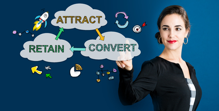 Attract Convert Retain concept with business woman on a dark blue background Banco de Imagens