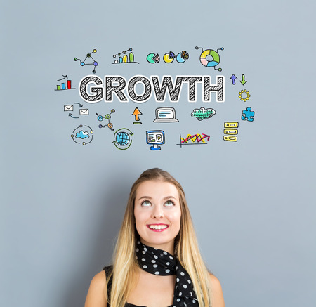 small business woman: Growth concept with happy young woman on a gray background