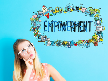 thoughtful: Empowerment concept with young woman in a thoughtful pose
