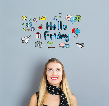 small business woman: Hello Friday concept with happy young woman on a gray background