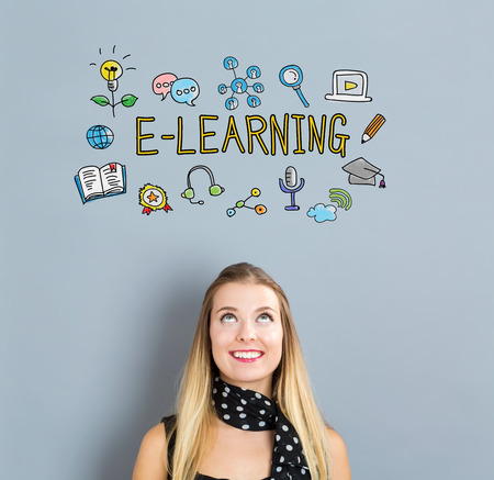 small business woman: E-Learning concept with happy young woman on a gray background Stock Photo
