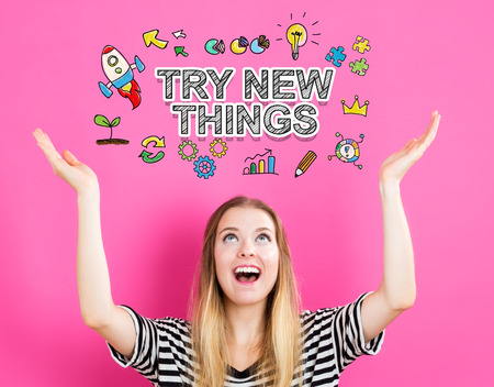 try: Try New Things concept with young woman reaching and looking upwards Stock Photo