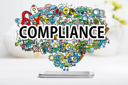 Compliance concept with smartphone on white table Stock Photo