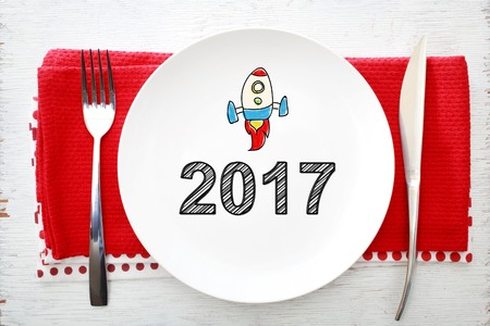 plate: 2017 concept on white plate with fork and knife on red napkins Stock Photo