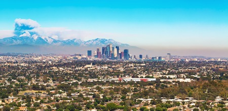 los angeles county: View of Los Angeles with smoke from a forest fire rising from the mountains behind