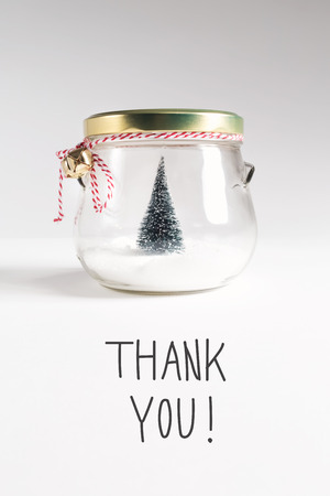 Thank You message with Christmas tree in a glass Jar Stock Photo