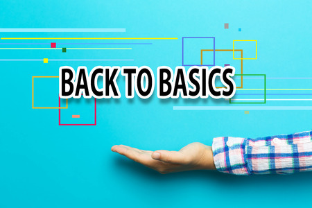 basic scheme: Back To Basics concept with hand on blue background