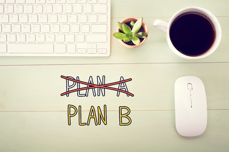 Plan B concept with workstation on a light green wooden desk