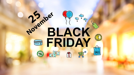 shopping center interior: Black Firday November 25 text on blurred illuminated shopping mall background