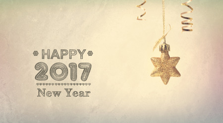 star ornament: Happy New Year 2017 message with a hanging star ornament