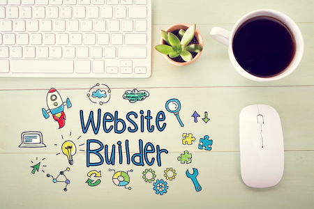 creation of sites: Website Builder concept with workstation on a light green wooden desk