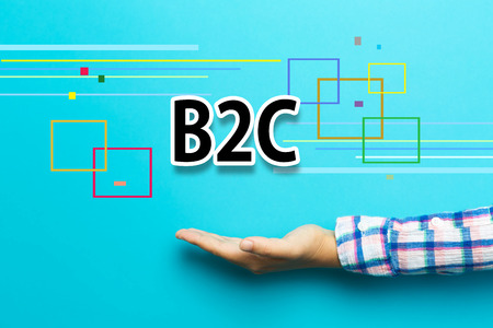 b2c: B2C concept with hand on blue background