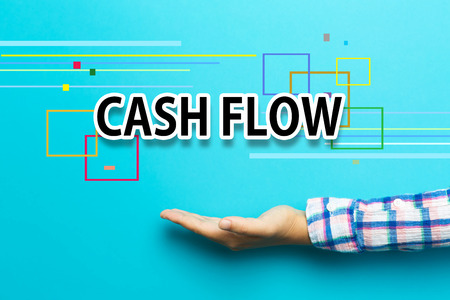 Cash Flow concept with hand on blue background