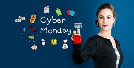 cyber woman: Cyber Monday concept with business woman on a dark blue background Stock Photo