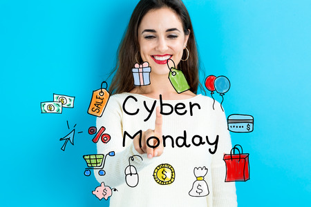 monday: Cyber Monday concept with young woman on blue background