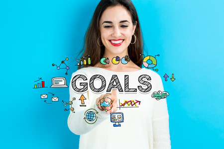 settings: Goals concept with young woman on blue background