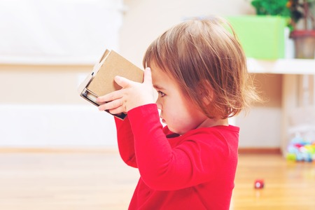 ar: Toddler girl using a new virtual reality headset