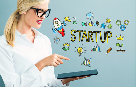 woman tablet: Startup text with business woman using a tablet Stock Photo